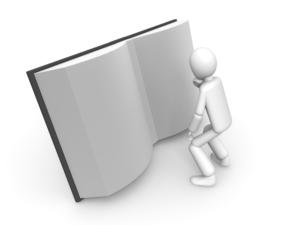 大きな本を読む人
